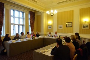 John chairing a meeting on psoriasis services in Carlisle with healthcare professionals